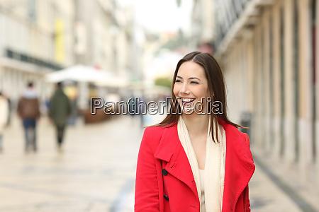 happy woman walking in the street