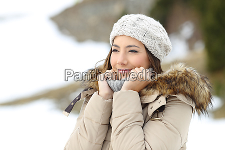 happy woman warmly clothed on winter
