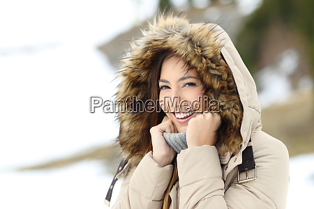 happy woman keeping warm in a