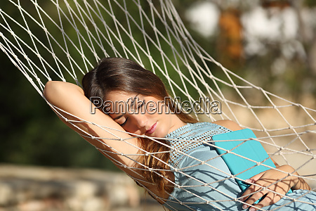 happy relaxed woman sleeping on vacation