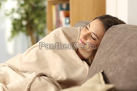 girl sleeping warmly on a comfortable