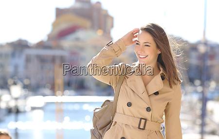 happy beautiful woman walking in the