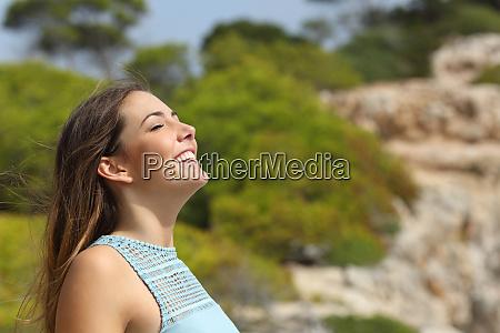 girl breathing fresh air in the