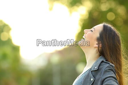 fashion woman breathing fresh air outdoors