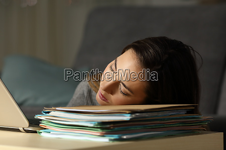 tired self employed sleeping over documents