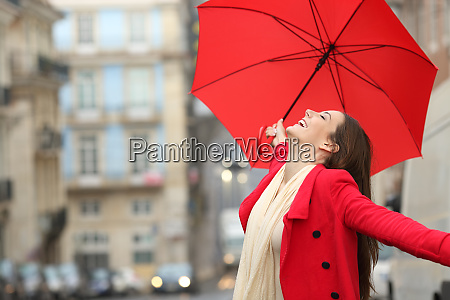 spontaneous woman celebrating under the rain
