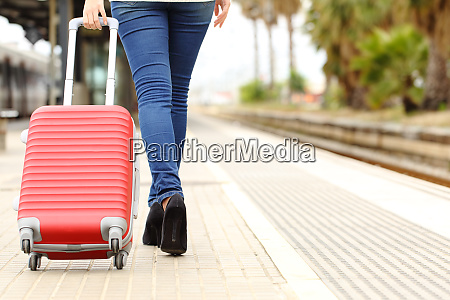 traveler legs walking carrying baggage in