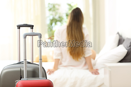 traveler relaxing in an hotel room