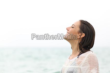 wet woman breathing fresh air on