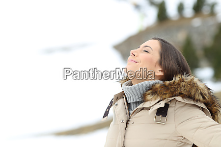 lady breathing fresh air on winter