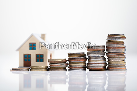 increasing coins and house model on
