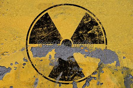black radioactive sign over yellow background