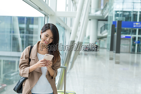 woman checking on cellphone at hong
