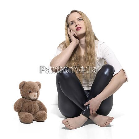young thoughtful woman cross legged