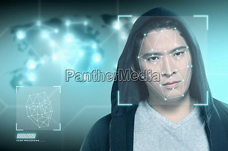 junge asiatische mann in schwarzen hoodie