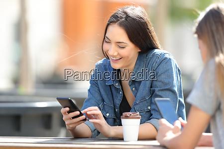 happy women using smart phones in