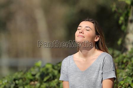relaxed girl breathing fresh air in