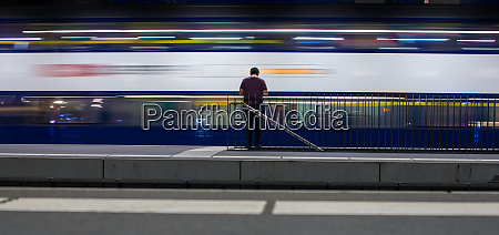 people in a trainstation with motion