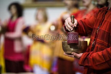 man playing on a tibetian singing