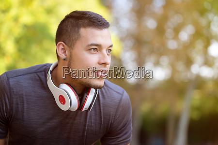 young latin man runner looking future