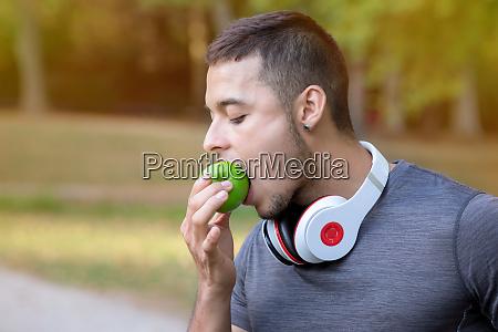 runner latin man eating apple running