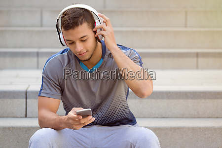 listening to music young latin man