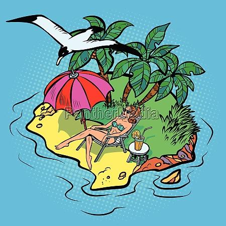 frau sonnenbaden auf einer tropischen insel