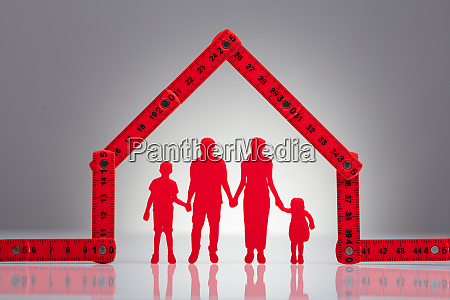family holding hands under in house