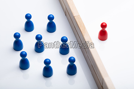 red and blue figurine pawn separated