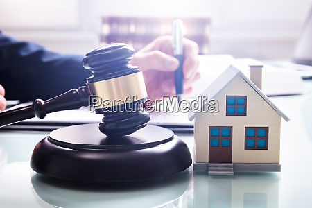 house model with gavel in front
