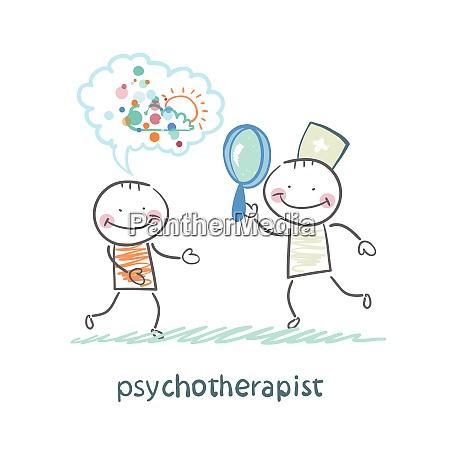 psychotherapeut der durch eine lupe auf