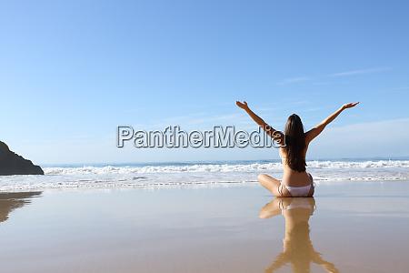 happy woman in bikini celebrating vacation