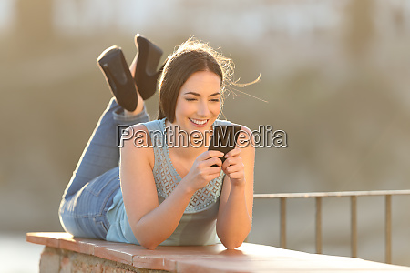 happy woman using a smart phone