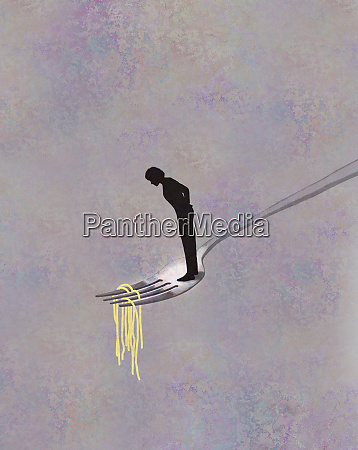 woman standing on large fork looking