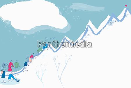 group of people climbing mountain towards