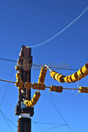 power lines coming off of pole