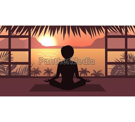 woman meditating in pose lotus sunrise