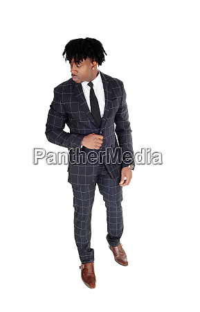 relaxed black man standing in a