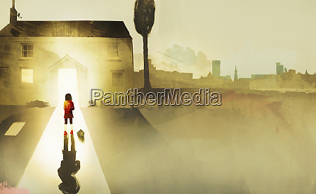 little girl standing alone on path