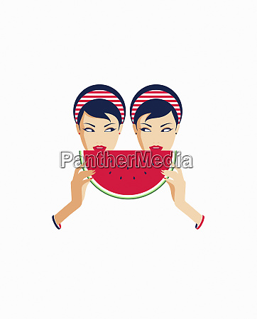 zwillingsfrauen teilen sich eine scheibe wassermelone