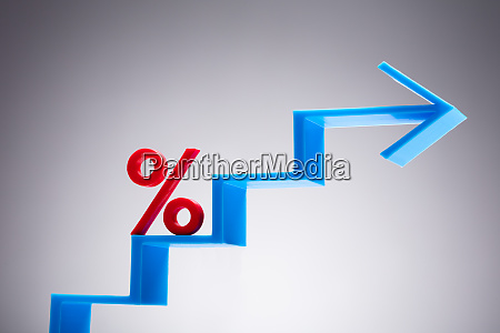 percentage sign on blue arrow