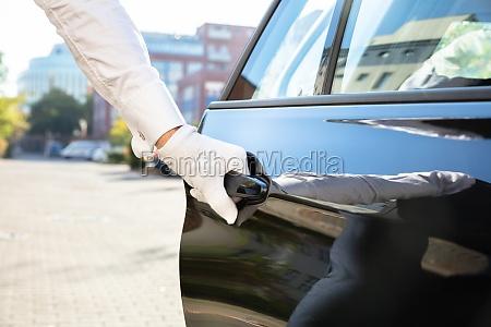 male valet opening car door