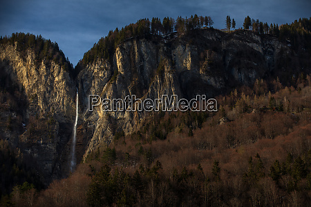 high waterfall within alpine scenery in