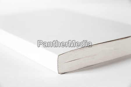 closed blank book isolated on grey