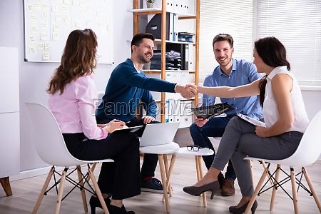 business people handshake im buero
