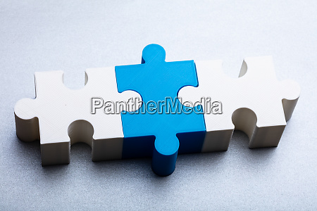 jigsaw puzzle block on white textured