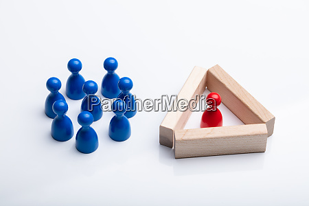 red figurine pawn separated by wooden