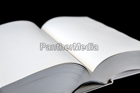 open blank dictionary book on black