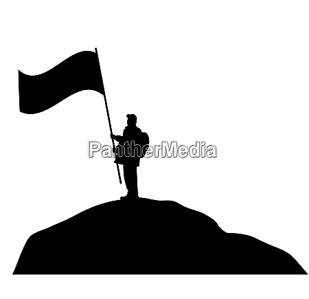 man waving large flag on a