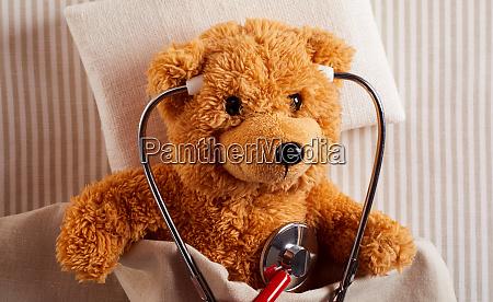 cute plush teddy bear using a